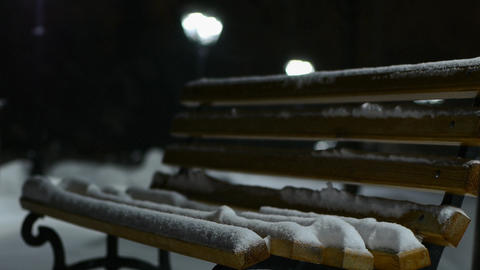 Snow falls on the bench Footage