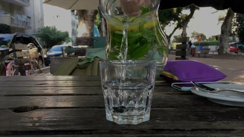 Lemonade pour liquid glass drink Footage