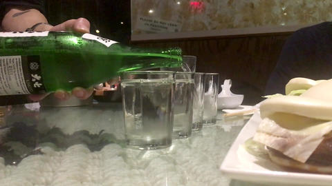 Sake bottle drink beverage pouring Live Action