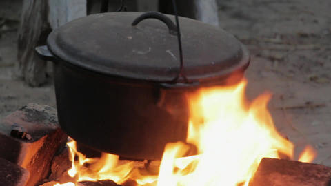 Pot fire cooking flames heat Footage