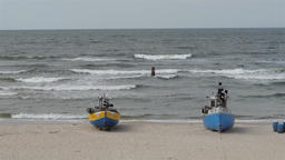 Fishing boats on the beach. Sea waves in slow motion 영상물