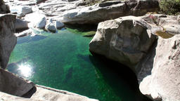 Reflection of sunlight in turquoise water of mountain river Verzasca Filmmaterial