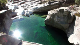 Reflection of sunlight in turquoise water of mountain river Verzasca 影片素材