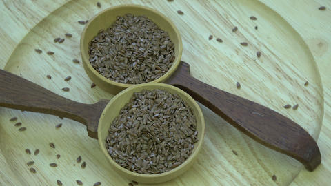 Rotating two wooden spoons with flax seeds Live Action