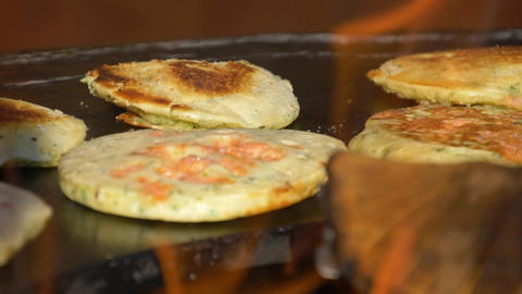 Pancake with carrots is baked on a stove with fire Filmmaterial