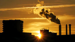refinery plant silhouette with chimney smoke against sunset 영상물