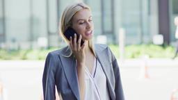 Businesswoman speaking on phone on street Footage