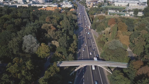 Aerial view of a car road with a bus lane GIF