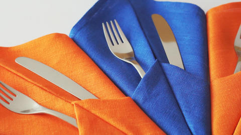 Cutlery for table setting. Forks and knives in table napkins GIF