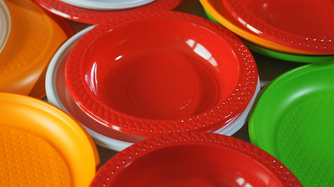Disposable plates. Stack of colorful plastic plates on the table Live Action