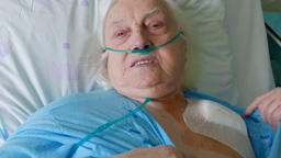 Old woman after surgery of implantation of heart pacemaker Filmmaterial