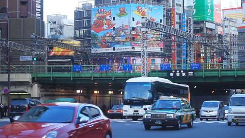 Train and Car come and go at Shinjuku intersection long shot ビデオ