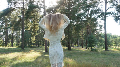 Beauty romantic young woman in dress in the forest on sunset 4k Filmmaterial