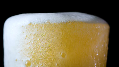 4K Slow motion pouring beer in to the glass Footage