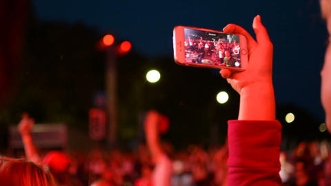 Recording a video with mobile phone iPhone during rock band music performance Footage