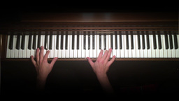 Ode to Joy is Played on Piano Overhead Shot Footage
