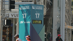 LA Marathon Participants Run Past Mile 17 Race Clock Footage