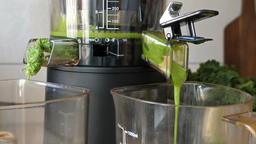 Process of extracting fresh juice from kale, apple and fresh mint Live Action