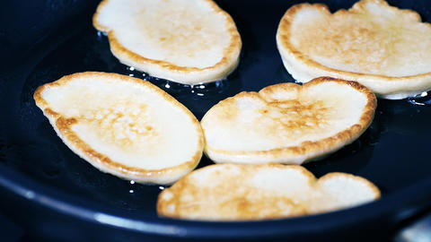 Pancakes are fried in a frying pan GIF