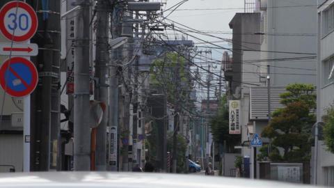 People walking under Electric line long shot deep focus at Hachiouji ビデオ