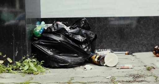 Litter lying on street Live Action