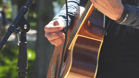 Hands of a man playing an acoustic guitar Footage