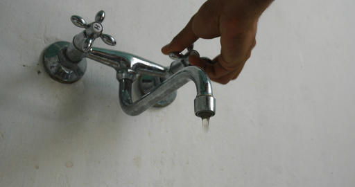 Dirty tap water Hand is opening faucet Live Action