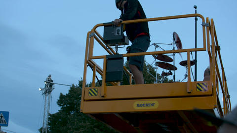 Riga, August 19: drummer with drum kit going up above the crowd on construction Footage