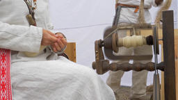 Woman is spinning wool on a spinning wheel 3 Live Action