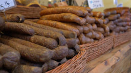 Farmers market. Traditional sausages for sale Live Action
