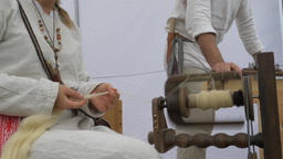 Spinning wheel. Woman is spinning wool Live Action