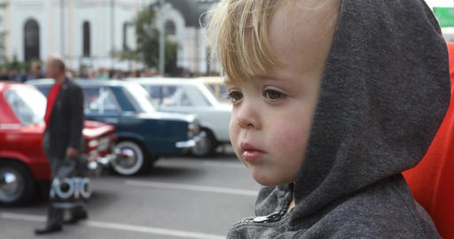 Serious baby looking at classic car Retro Show Stock Video Footage