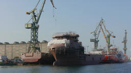 Shipyard in Gdansk, Poland and ships in docks during renovation Live Action