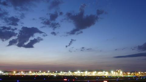 Illuminated runways and buildings at Frankfurt airport at dusk Footage