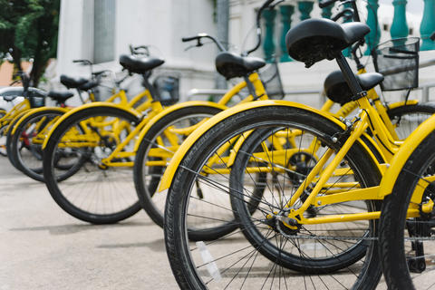 Line of Yellow Bicycles in Thai Temple Photo