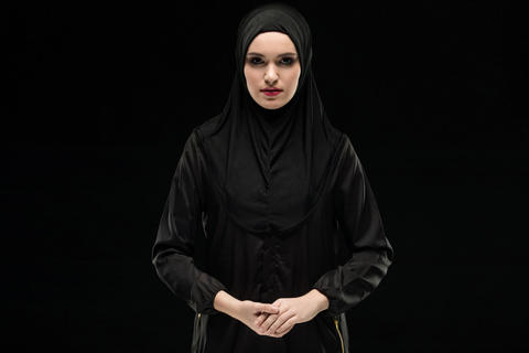 Portrait of young Muslim woman in traditional clothes Photo