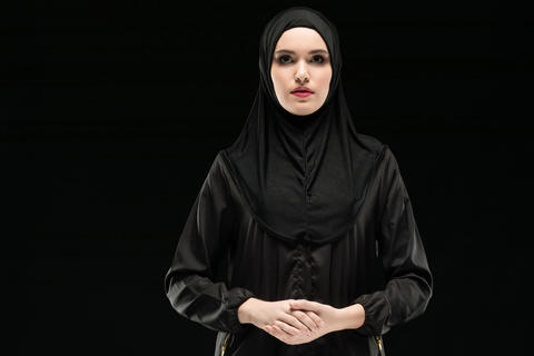 Portrait of young Muslim woman in traditional clothes フォト