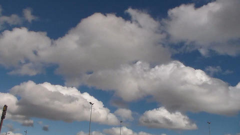 running white clouds in blue sky background. Accelerated video. Timelapse GIF