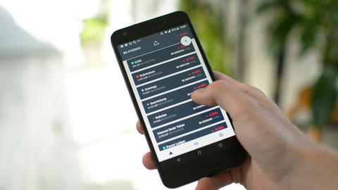 Checking cryptocurrency portfolio balance in mobe app Live Action