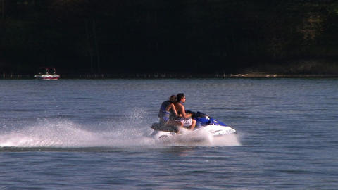 Young Couple on Jet Ski Filmmaterial