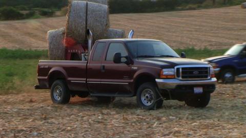 Trucks Hauling Hay Bales Stock Video Footage