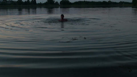 Man bathes in the lake Stock Video Footage