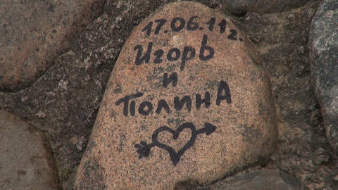 The inscription on the granite rock Stock Video Footage