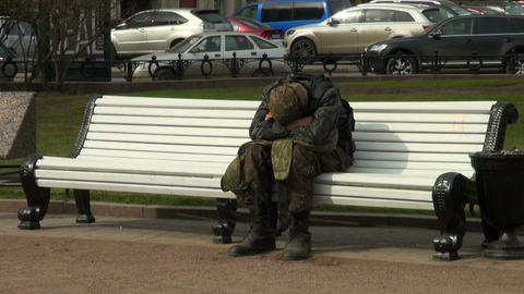 Soldiers sleeps on a bench Stock Video Footage