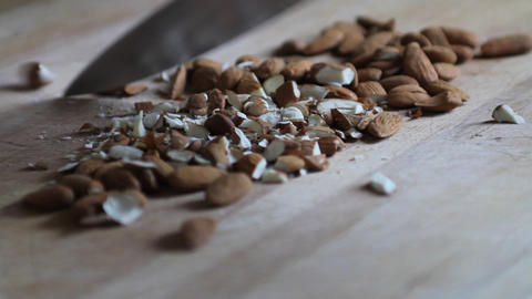 Hand of a woman chopping almonds Stock Video Footage