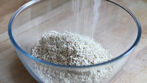 Pouring oats in a bowl Stock Video Footage