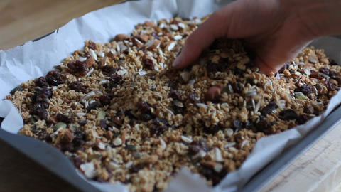 Hand of a woman touching granola Stock Video Footage