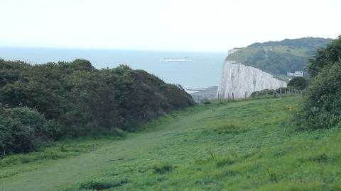 White cliffs of Dover, with ferry Stock Video Footage