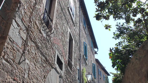 Little Italian street with bridge in Cortona Stock Video Footage