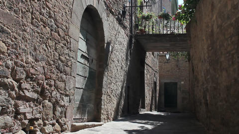 Little Italian street with bridge in Cortona Footage